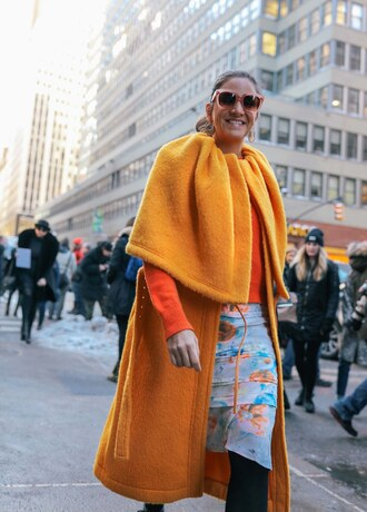coat orange sweater nyfw 2017 fashion week 2017 fashion week streetstyle orange orange coat sweater skirt floral floral skirt tights opaque tights sunglasses