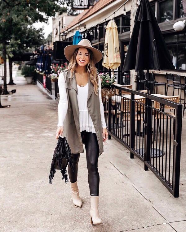 pants leggings faux leather ankle boots high heels boots vest white blouse v neck straw hat handbag
