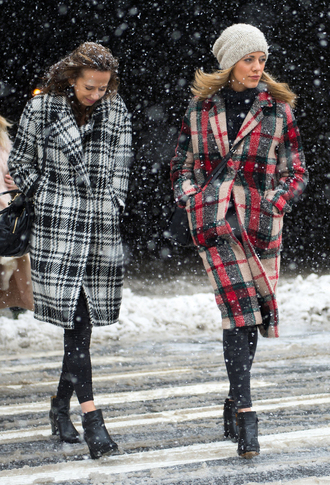 coat nyfw 2017 fashion week 2017 fashion week streetstyle printed coat tartan plaid beanie leggings black leggings boots black boots ankle boots winter outfits winter look