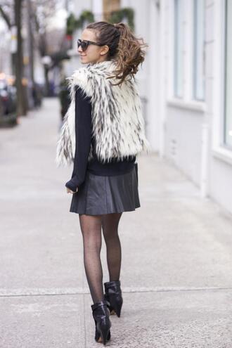 something navy blogger tights faux fur vest leather skirt skirt shirt jacket shoes bag sunglasses printed fur vest