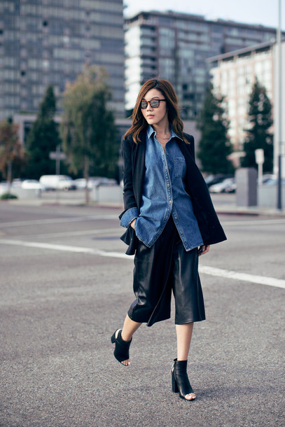 tsangtastic blogger sunglasses culottes leather shorts denim shirt peep toe boots black culottes leather culottes leather pants black pants palazzo pants shirt blue shirt mirrored sunglasses coat black coat