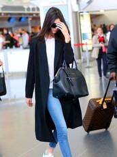 coat,kendall jenner,white kendall jenner black,black,jeans,style,bag,designer bag,white,blue,light blue jeans,shoes,streetwear,victoria's secret,victoria's secret model,airport style