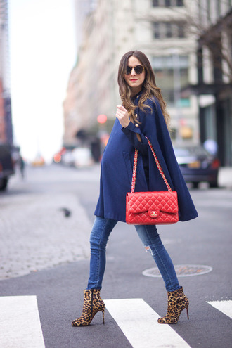 something navy blogger jeans shoes bag sunglasses top blue coat red bag chanel chanel bag skinny jeans ripped jeans animal print boots all navy blue outfit