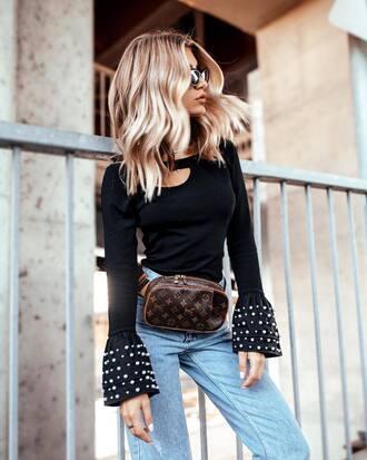 sweater bell sleeves louis vuitton tumblr black top fanny pack belt bag denim jeans blue jeans