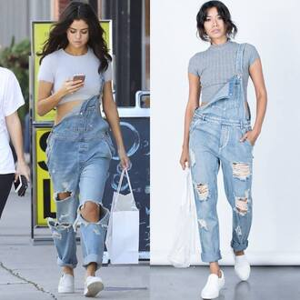 jeans 2020ave denim overalls ripped jeans distressed denim selena gomez selena gomez jeans celebrity style summer outfits fall outfits crop tops top white sneakers sneakers slip on shoes low top sneakers shoes