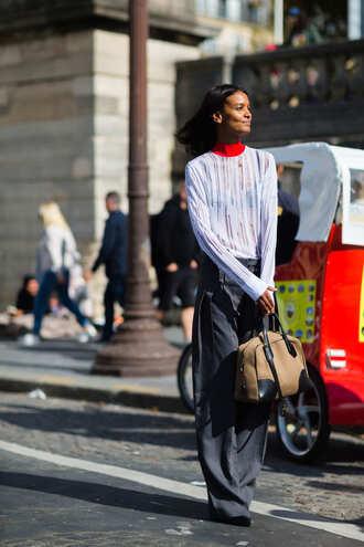top fashion week street style fashion week 2016 fashion week white top long sleeves pants grey pants wide-leg pants bag nude bag streetstyle paris fashion week 2016