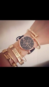 jewels,watch,watch colors,gold watch,lovely,beautiful,underwear,geneva,rose gold,black,leather,gold,bracelets,gold bracelet,stacked bracelets,cuff bracelet,jewelry,quote on it,nail accessories