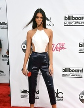 shirt,kendall jenner,halter top,open back,red carpet,jumpsuit,black and white,black,white,kardashians,style,blouse,pants,white top,cut-out,halter neck,black pants,sequins,keeping up with the kardashians