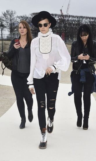 jeans ripped jeans cara delevingne fashion week 2015 blouse white blouse black ripped jeans sunglasses hat