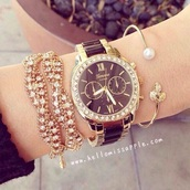 jewels,gold,gold jewelry,bracelets,gold bracelet,leaf motif,pearl,watch,black,black watch,geneva,women watches,strass,cute,girly,jewelry,stacked bracelets