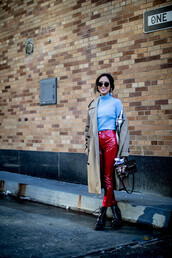 pants,nyfw 2017,fashion week 2017,fashion week,streetstyle,coat,camel,camel coat,trench coat,top,blue top,turtleneck,red pants,leather pants,vinyl,boots,black boots,ankle boots,high heels boots,patent shoes,patent boots,bag,boxed bag,sunglasses,00s style