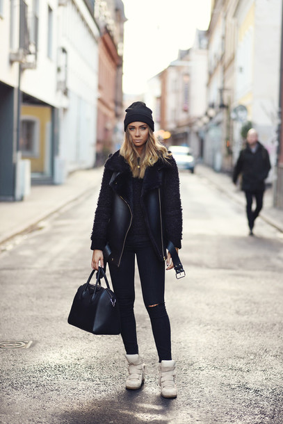 lisa olsson blogger white sneakers high top sneakers shearling jacket winter jacket shearling vest vest black vest shearling black sweater black bag beanie black jeans all black everything