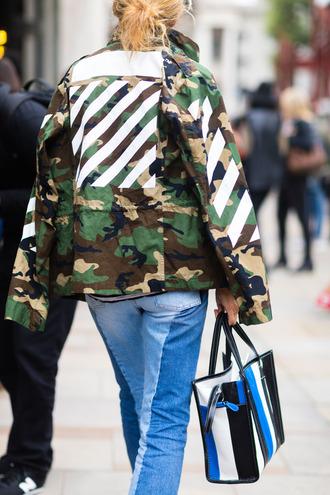 jacket fashion week street style fashion week 2016 fashion week london fashion week 2016 camouflage army green jacket denim jeans blue jeans bag striped bag stripes streetstyle fall outfits
