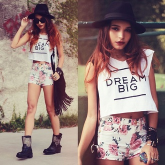 shirt crop tops flowered shorts floral flowers roses pretty dream dream big high waisted shorts purse fringes combat boots boots shoes white black and white quote on it studs outfit t-shirt studded shoes shorts tank top teenagers indie fedora shades sleeveless bag hat