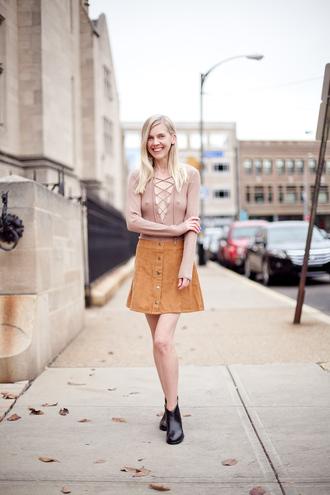 cocorosa blogger suede skirt button up skirt lace up top lace up bodysuit nude bodysuit bodysuit mini skirt camel skirt black boots ankle boots long sleeve bodysuit