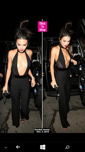jumpsuit,black jumpsuit,plunge v neck,black heels,kendall jenner,birthday dress,turtleneck,bun,hair bun,red lipstick,black,tight,bodycon,bodycon dress,cleavage,cleavage dress,bodysuit,see through,v neck,all black everything