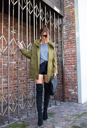 blogger,thigh high boots,army green jacket,black shorts,sunglasses,jacket,shorts,bag,shoes,leather shorts,knee high boots,khaki,over the knee boots,blouse