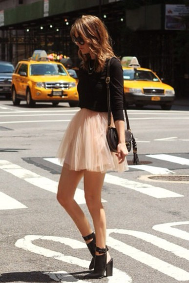 black heels skirt ballet pink black long sleeve shirt black purse round sunglasses