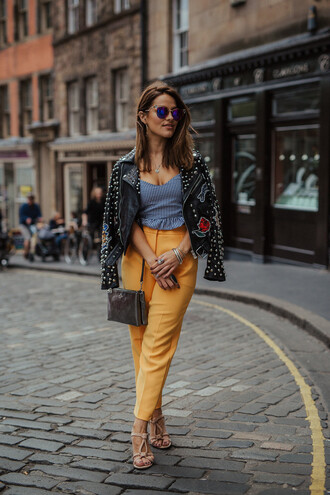 pants tumblr yellow yellow pants top blue top jacket black jacket leather jacket black leather jacket studded studded jacket sunglasses bag shoes jewels