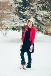 the clothes,blogger,red jacket,winter boots,duck boots,pom pom beanie,black dress,gloves,hat,coat,cardigan,dress,tights,shoes,knitted gloves