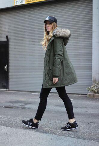 shoes green jacket black cap black skinny jeans new balance sneakers blogger