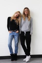 sweater,grey sweater,victoria's secret model,blonde hair,sweatpants,pants,jeans,shirt,black,cotton,black sweatpants,sweatshirt,sporty,nike pants,white string,converse