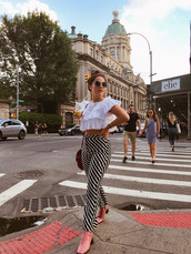 pants,printed pants,high waisted,boots,crop tops,white crop tops,sunglasses,bag