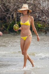 swimwear,yellow,yellow swimwear,alessandra ambrosio,bikini,bikini top,bikini bottoms,beach,hat