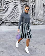 bag,handbag,round bag,ankle boots,white boots,mid heel boots,midi skirt,striped skirt,button up skirt,turtleneck,white sunglasses,earrings