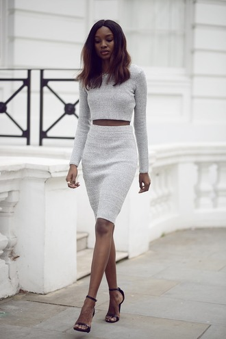 top grey long sleeved crop top plain crop top model candid streetstyle two-piece tight skirt professional matching grey skirt