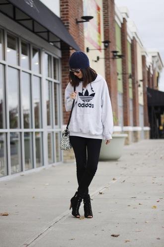 sweater blue beanie white hoodie black leggings black cutout boots blogger sunglasses