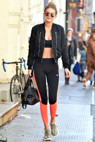 jacket gigi hadid workout leggings sportswear sports bra yeezy running shoes sunglasses mirrored sunglasses bomber jacket bag celebrity style celebrity orange crop tops bra