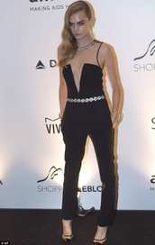 dress,cara delevingne,model,high heels,black,jumpsuit,blonde hair,shoes,belt,jewels,pants,chic,style,pantsuit,deep v,low cut,black jumpsuit