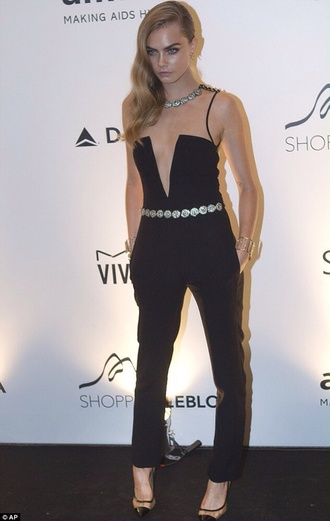 dress cara delevingne model high heels black jumpsuit blonde hair shoes belt jewels pants chic style pantsuit deep v low cut black jumpsuit