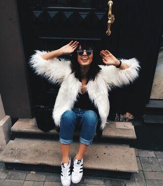 coat white fur coat fur coat white coat jeans denim blue jeans cuffed jeans top black top sunglasses sneakers low top sneakers white sneakers adidas adidas shoes adidas superstars fall outfits white fur jacket