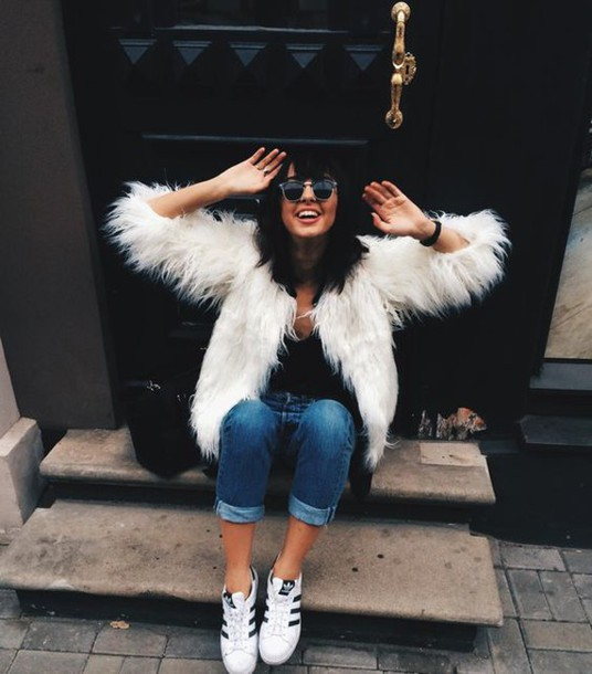 coat white fur coat fur coat white coat jeans denim blue jeans cuffed jeans top black top sunglasses sneakers low top sneakers white sneakers adidas adidas shoes adidas superstars fall outfits white fur jacket