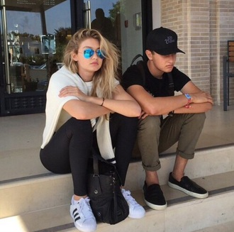 sunglasses mirrored sunglasses gigi hadid adidas jeans tumblr black jeans sneakers white sneakers low top sneakers adidas shoes adidas superstars top white top blue sunglasses celebrity style celebrity model model off-duty menswear mens shoes mens pants mens t-shirt mens cap