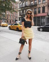 sunglasses,black sunglasses,yellow skirt,platform sandals,bag,shirt