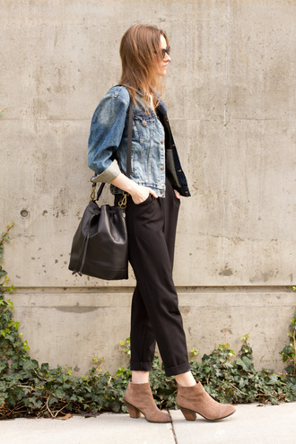 styling my life blogger black jumpsuit bucket bag ankle boots suede shoes denim jacket