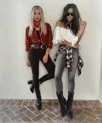 shirt cold shoulder ashley benson celebrity actress celebrity style tartan shirt bandana red bandana jeans black jeans boots high heels boots black boots block heel boots block heels cowboy boots grey jeans top white top crop tops white crop tops off the shoulder top sunglasses black sunglasses shay mitchell
