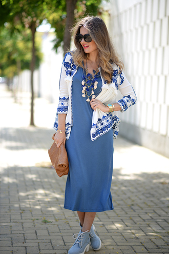 mi aventura con la moda blogger blue dress leather clutch tassel