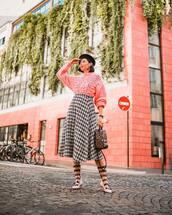 skirt,midi skirt,wool,pleated skirt,flats,backpack,sweater,knitwear,knitted sweater,beret,earrings