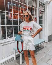 top,white shirt,logo,white shorts,High waisted shorts,bag,sunglasses