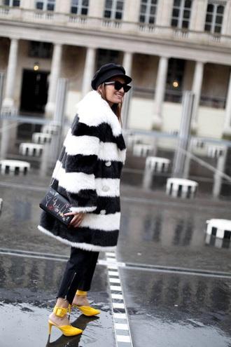 shoes yellow shoes pants black pants coat striped coat oversized coat hat bag high heels heels fur coat