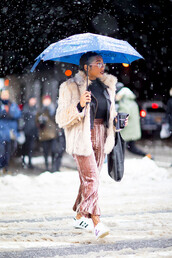 pants,nyfw 2017,fashion week 2017,fashion week,streetstyle,pink pants,velvet,cropped velvet pants,velvet pants,tights,net tights,fishnet tights,sneakers,white sneakers,adidas,adidas shoes,adidas superstars,top,black top,jacket,nude jacket,fur jacket,faux fur jacket,umbrella,bag,winter outfits,winter jacket,winter look,cropped wide-leg velvet pants,wide-leg velvet pants