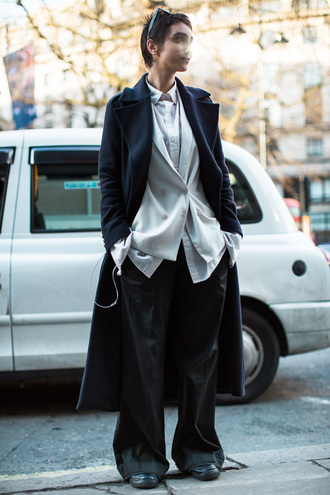 coat london fashion week 2017 fashion week 2017 fashion week streetstyle black coat shirt white shirt blazer white blazer pants black pants wide-leg pants androgynous no gender