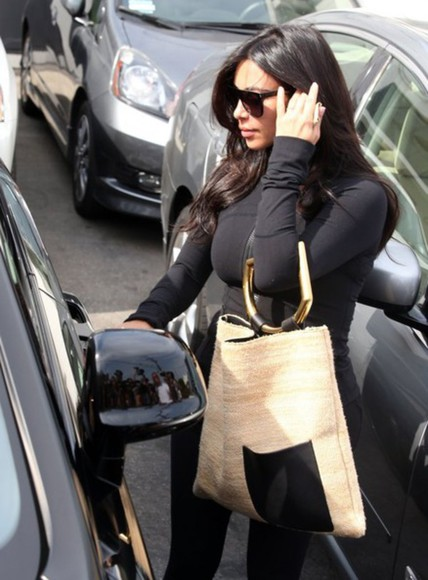 kim kardashian black jacket sunglasses bag
