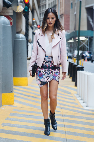 skirt ankle boots jacket leather jacket jamie chung fall outfits streetstyle pink coat pink jacket printed skirt asymmetrical skirt black boots