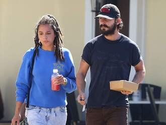 top blue sweater sasha lane shia labeouf celebrity style celebrity actress sweatshirt blue top shorts denim shorts blue shorts mens t-shirt menswear mens cap hairstyles dreadlocks