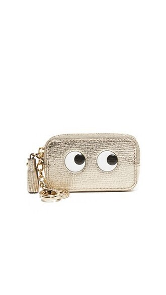 eyes light purse gold bag